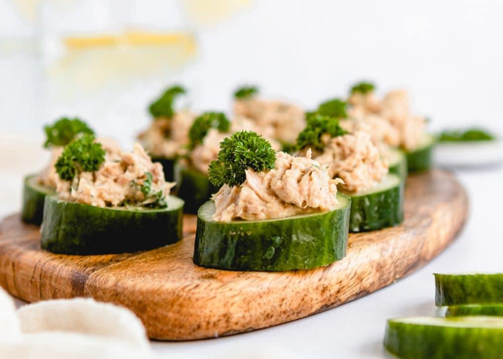 cucumber tuna cups on a wooden cutting board