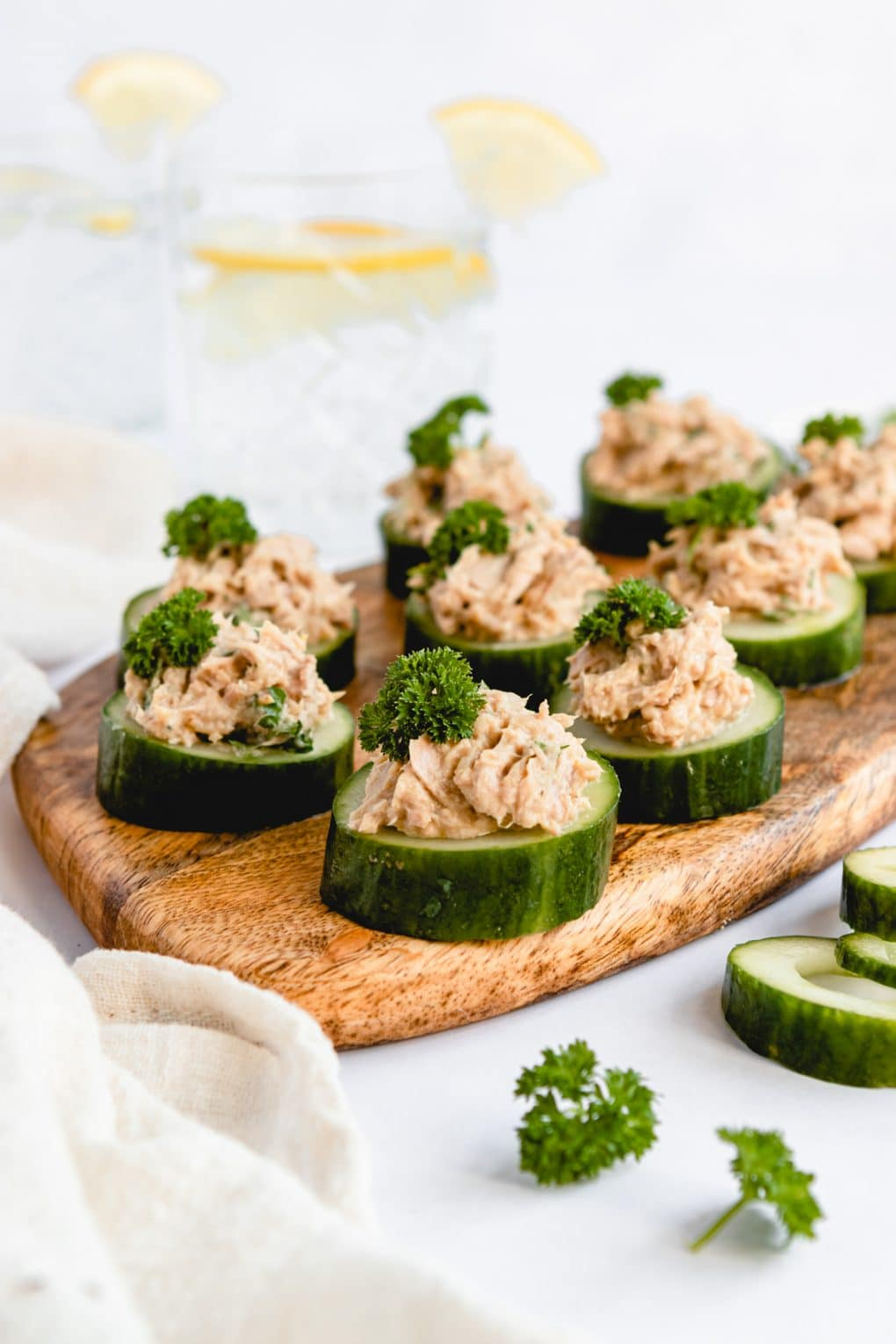 cucumber tuna cup appetizers on a tray