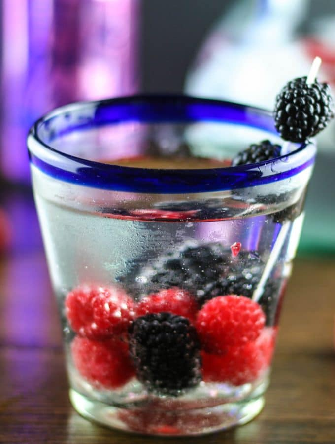 a la croix berry vodka spritzer in a low ball glass