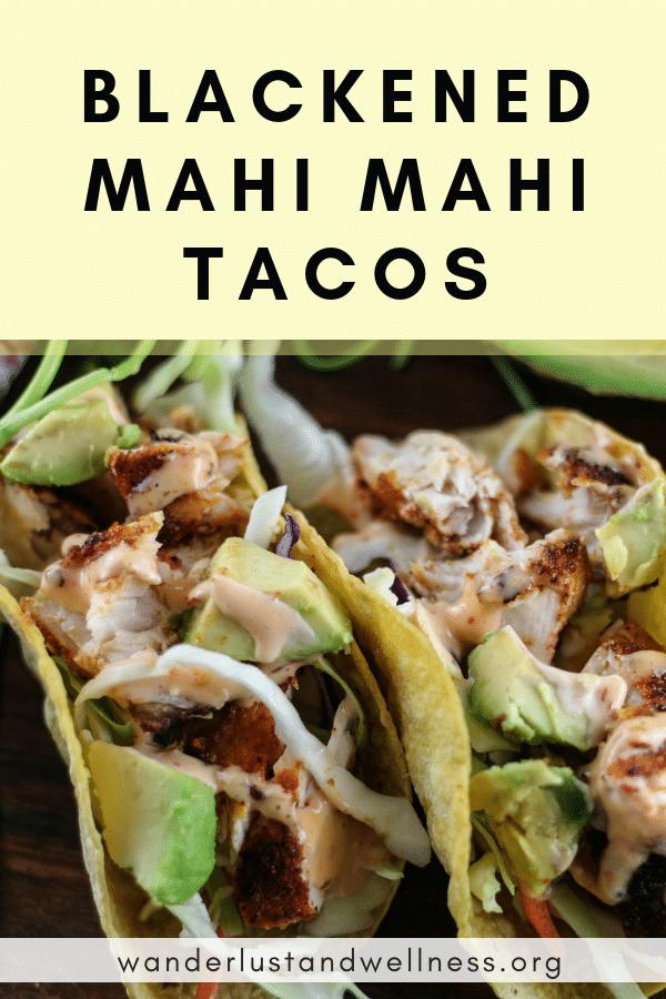 two blacked mahi mahi tacos with avocado, slaw, and a creamy sauce