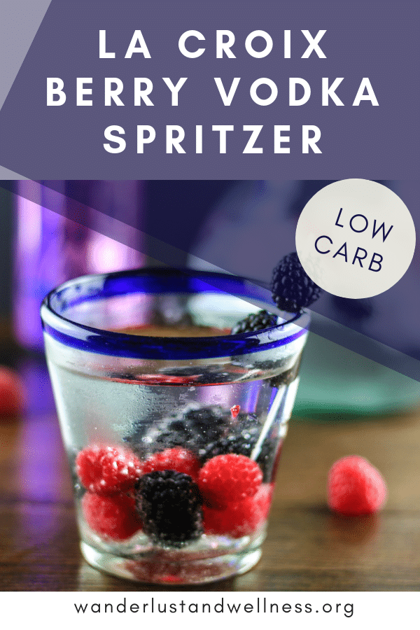 a la croix berry vodka spritzer in a low ball glass with fresh berries