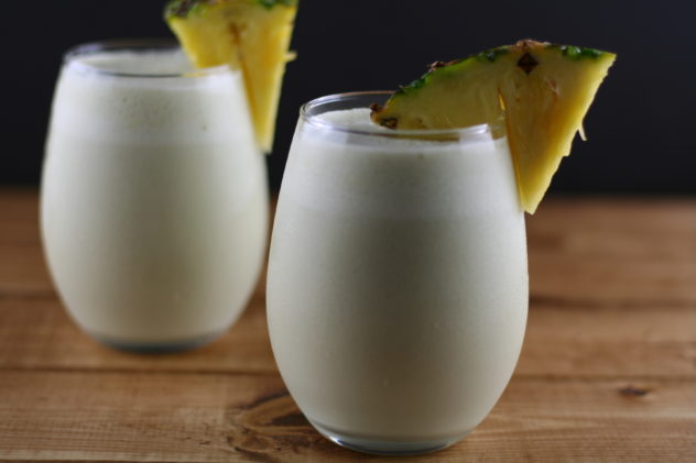 two glasses of coconut pineapple matcha smoothie