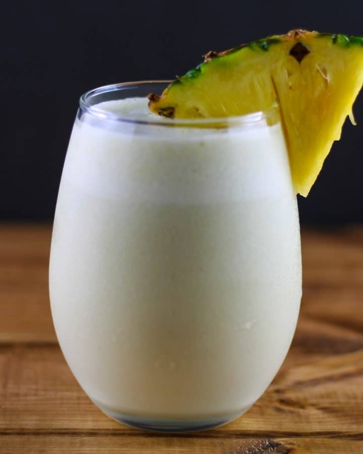 a glass of coconut pineapple matcha smoothie
