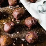 chocolate pumpkin truffles on a wooden table