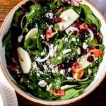 a bowl of apple cranberry Thanksgiving salad