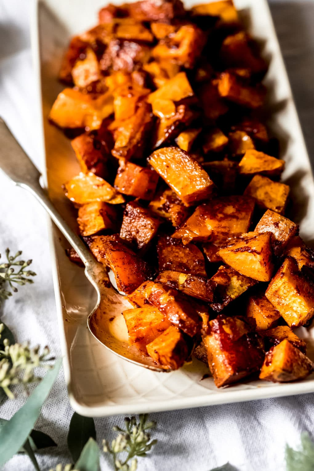 a serving dish with cinnamon honey sweet potatoes