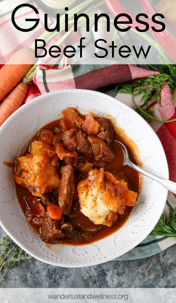 a bowl of guinness beef stew with garlic cheddar dumplings