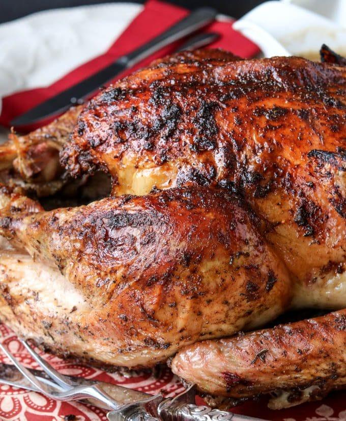 maple herb turkey on a platter for Thanksgiving dinner