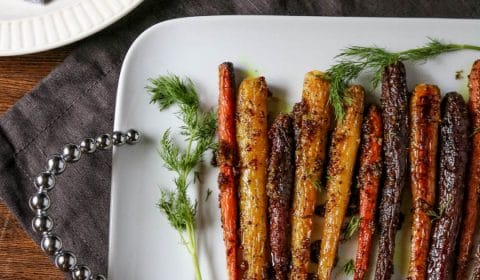 a white platter of maple mustard roasted carrots