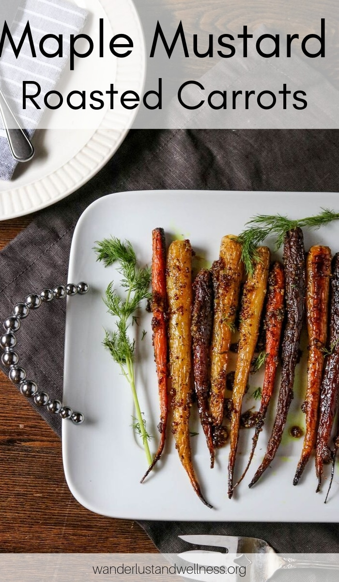 a platter of maple mustard roasted carrots on a wooden table