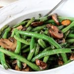 a dish of sautéed green beans and mushrooms