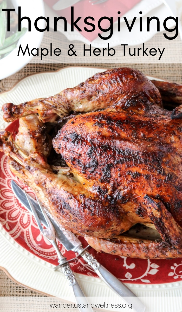 a thanksgiving maple herb turkey on a platter