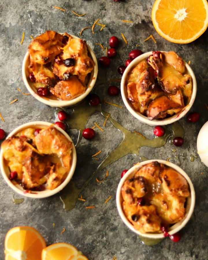 four ramekins of orange cranberry bread pudding