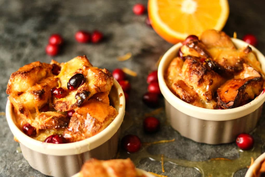 two ramekins of orange cranberry bread pudding