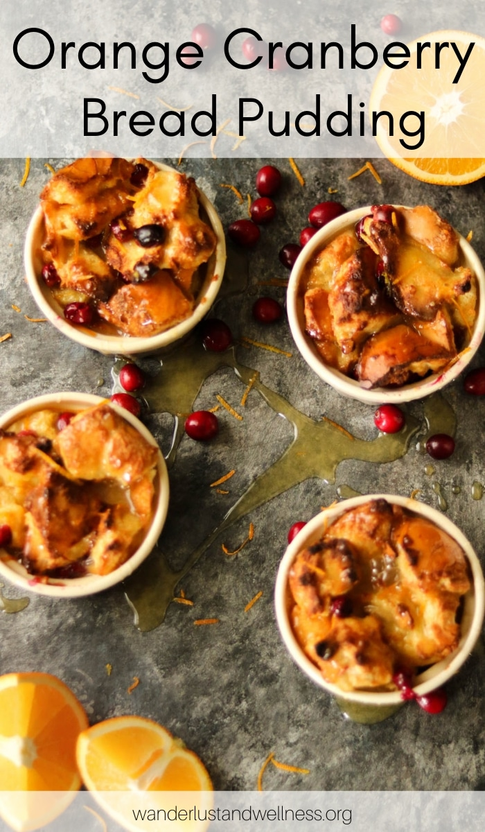 four ramekins of orange cranberry bread pudding