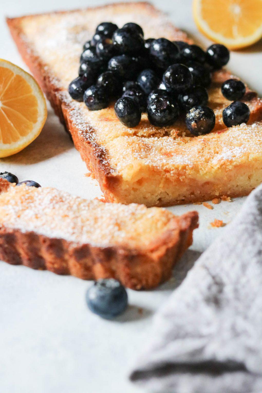 a lemon blueberry shortbread tart on a table