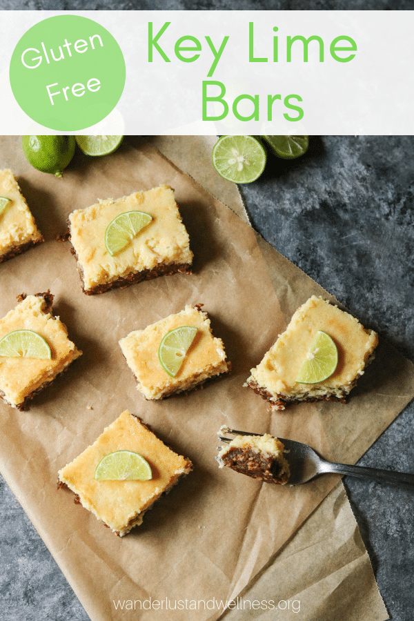 several gluten-free key lime bars sitting on parchment paper