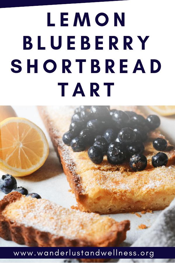 a lemon blueberry shortbread tart with fresh blueberries on top