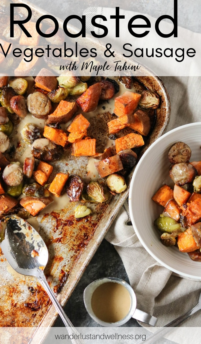 a sheet pan of pan-roasted vegetables and sausage with maple tahini