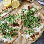 Prosciutto Burrata Pizza with Fig Jam on parchment paper