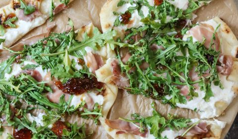 Prosciutto Burrata Pizza with Fig Jam on parchment paper