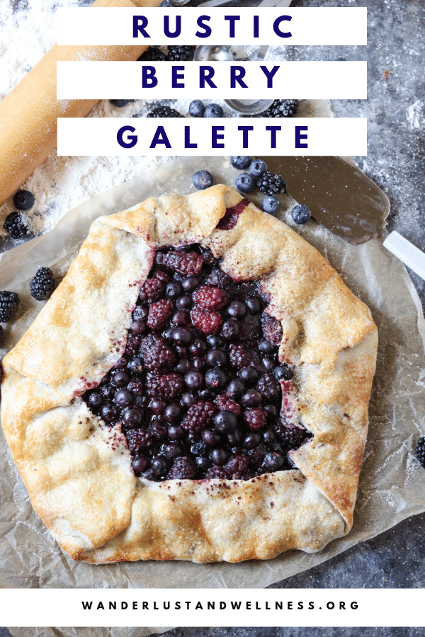 a rustic berry galette sitting on a table