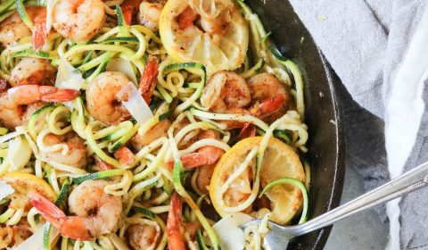 blackened lemon shrimp with zucchini noodles in a cast iron skillet