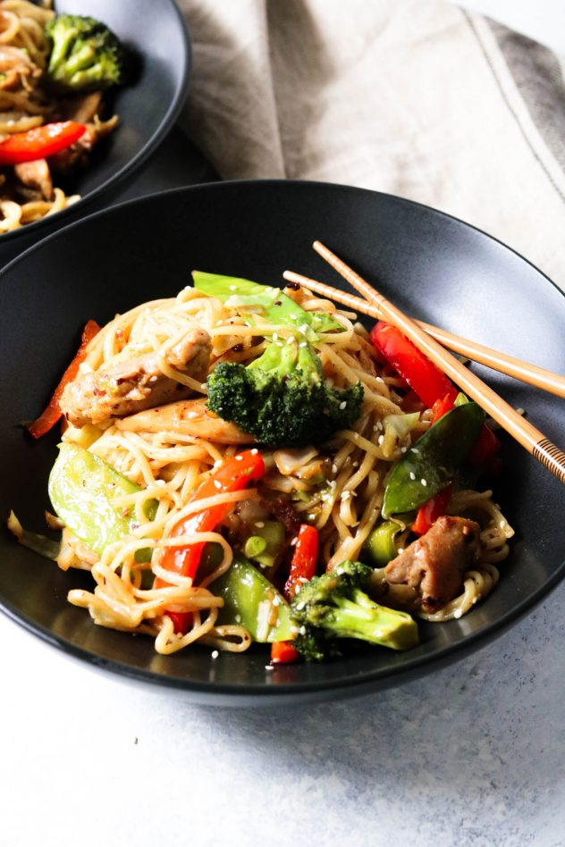 bowl of chicken lo mean with chopsticks