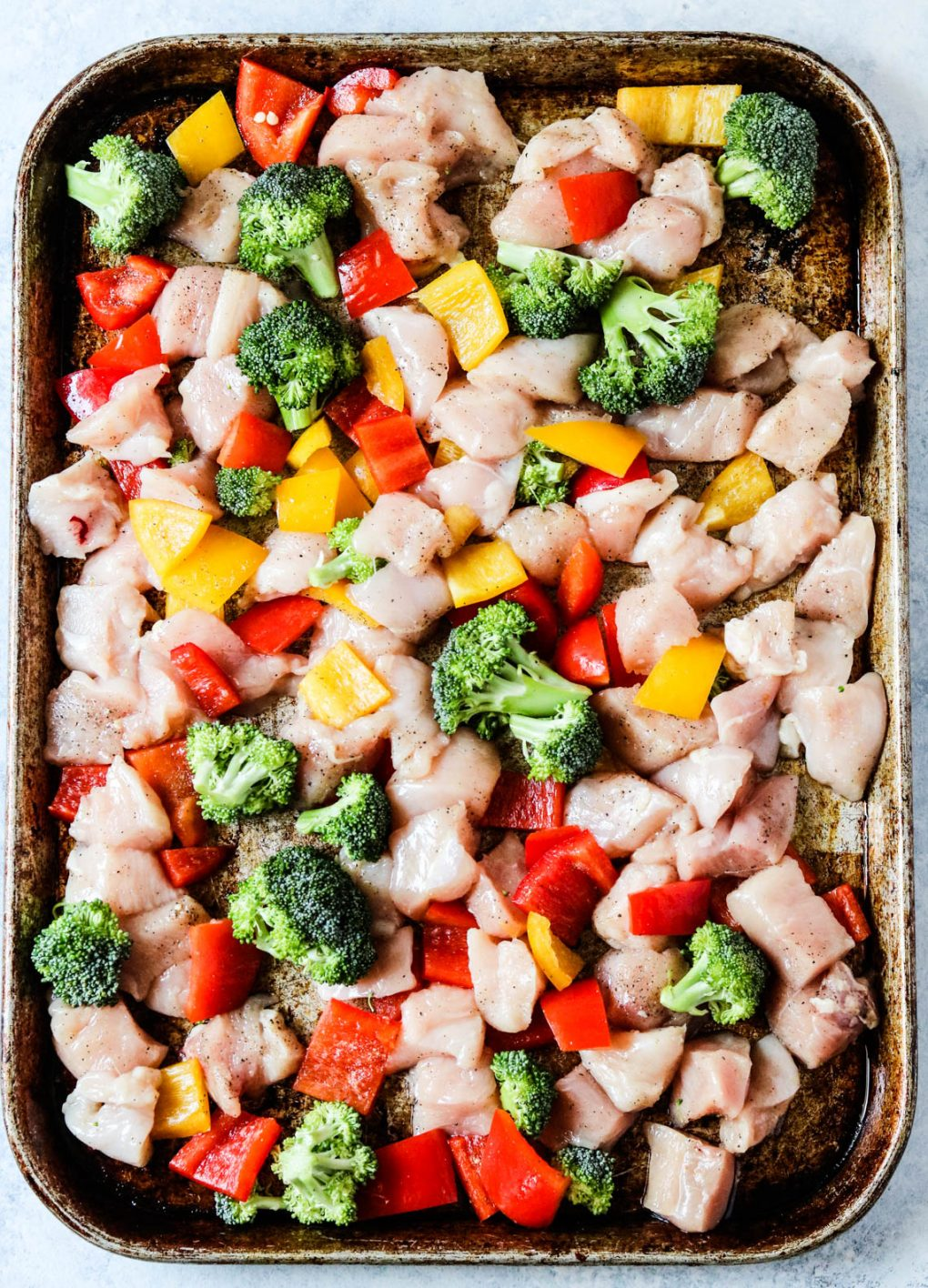 sheet pan sweet and spicy chicken ingredients before cooking