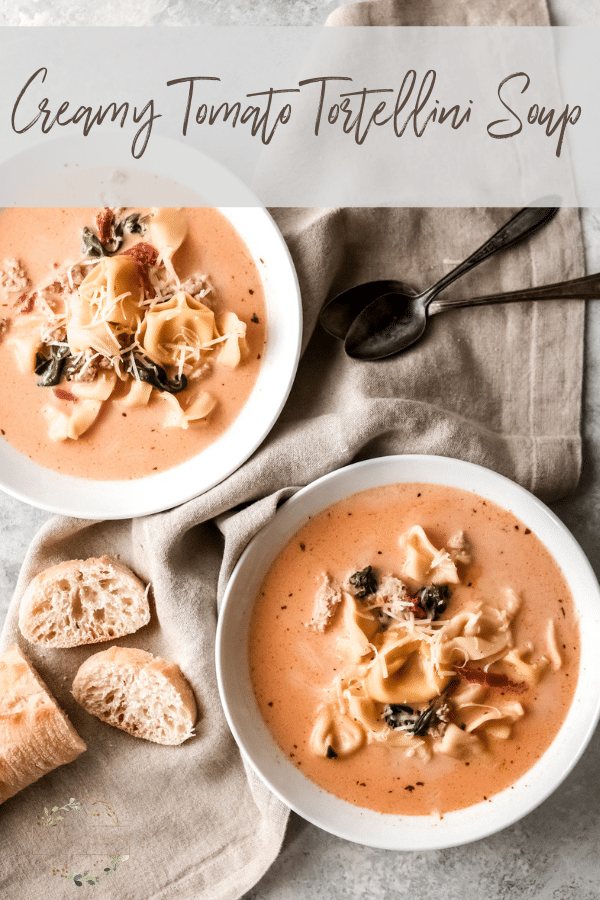 two bowls of creamy tomato tortellini soup