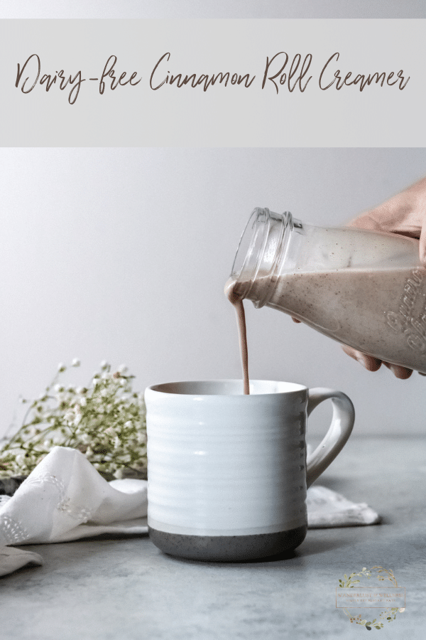 someone pouring the dairy-free cinnamon roll coffee creamer into a cup of coffee