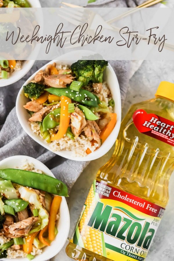 bowls of chicken stir-fry with a bottle of Mazola corn oil