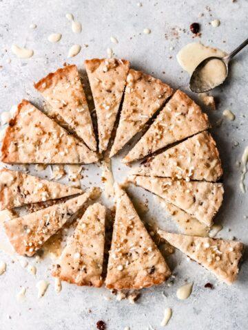 orange cranberry shortbread cookies cut into 12 pie-shaped cookies