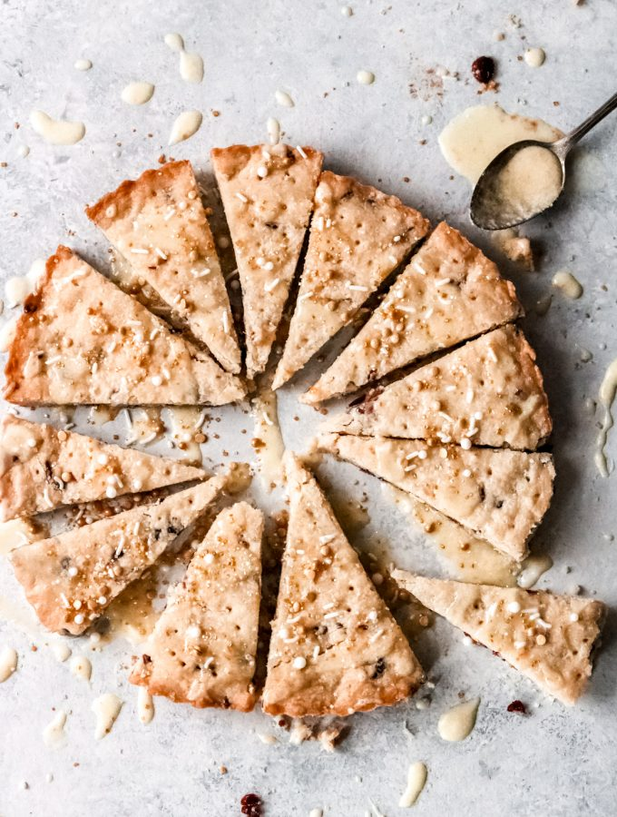 orange cranberry shortbread cookies cut into 12 pie-shaped cookies