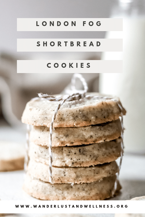 A stack of five London fog shortbread cookies, wrapped with string, and a jug of milk in the background