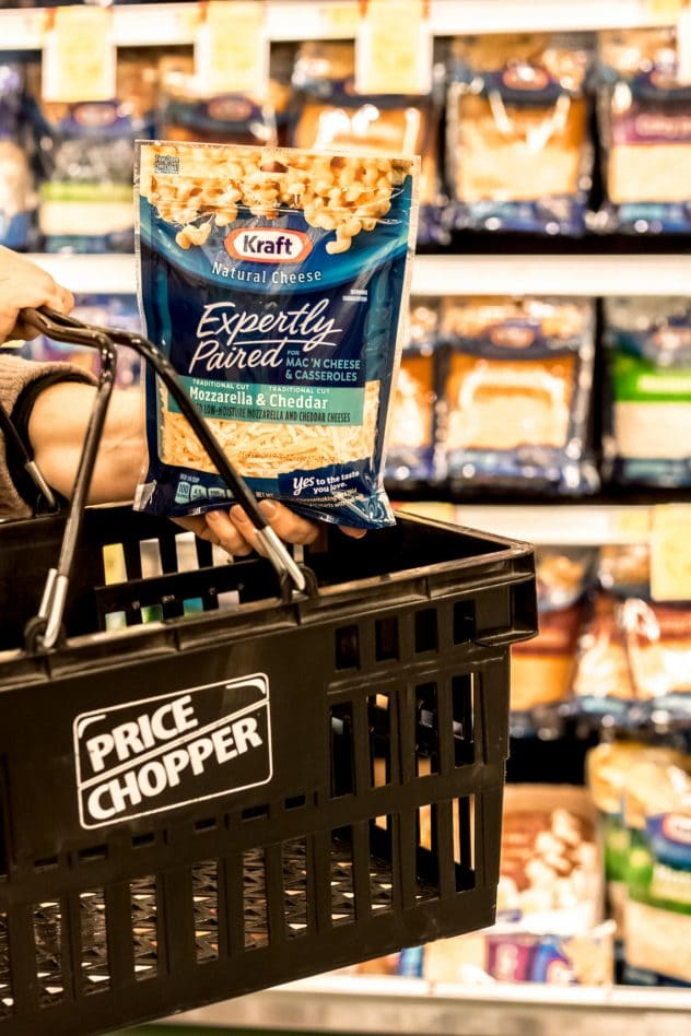 a person shopping in Price Chopper for KRAFT® Expertly Paired for Mac 'n Cheese & Casseroles, Mozzarella & Cheddar (8 oz.) bag