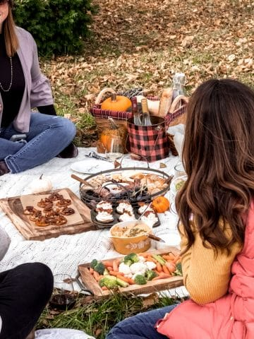 an outdoor fall picnic scene for friendsgiving