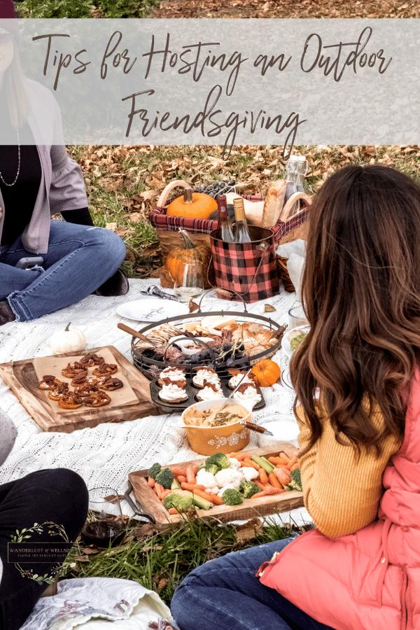 an outdoor fall picnic scene for friendsgiving