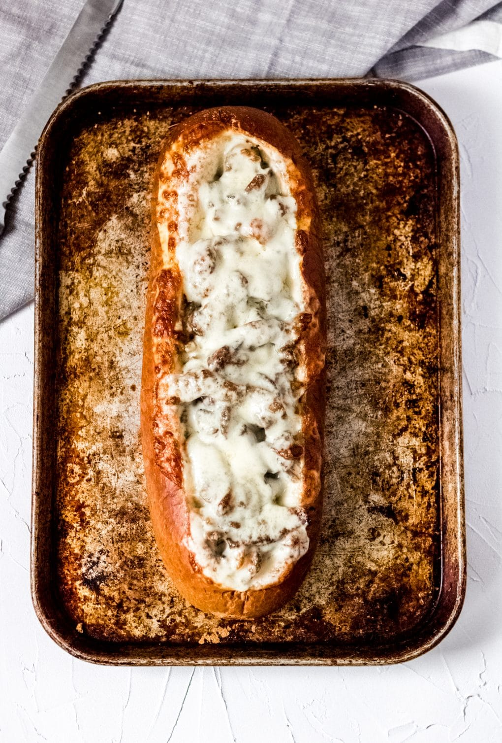 a loaf of philly cheesesteak stuffed french bread