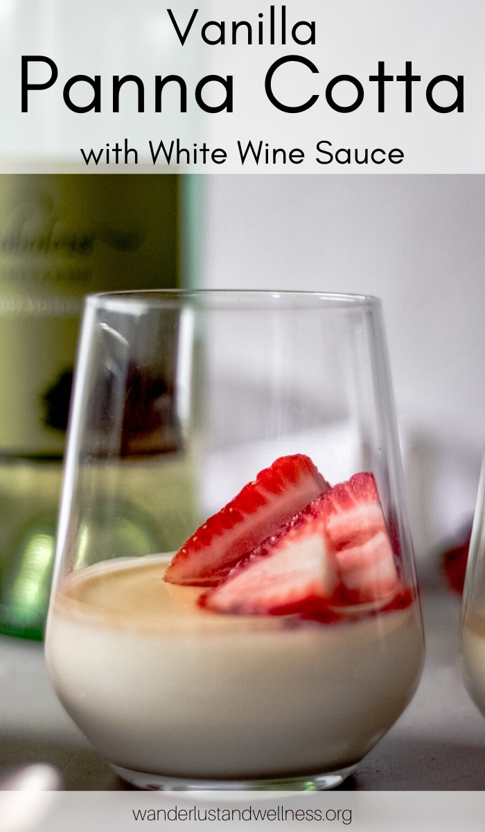 a glass of panna cotta with white wine sauce