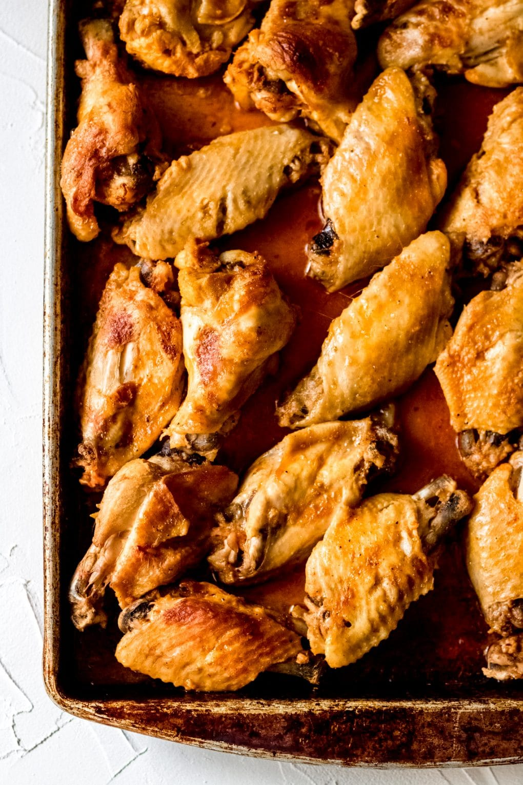 a sheet pan of chicken wings that have been broiled