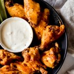 a bowl of chicken wings with blue cheese sauce