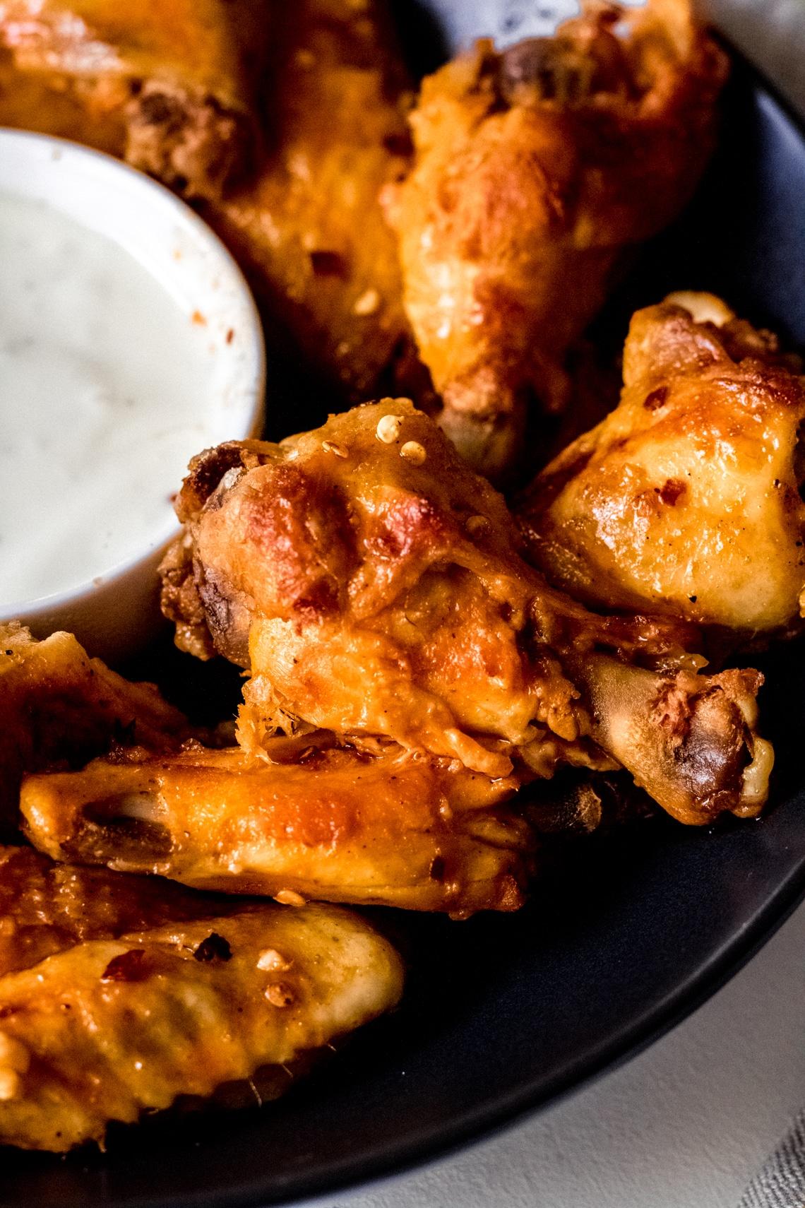 a close up shot of crock pot chicken wings
