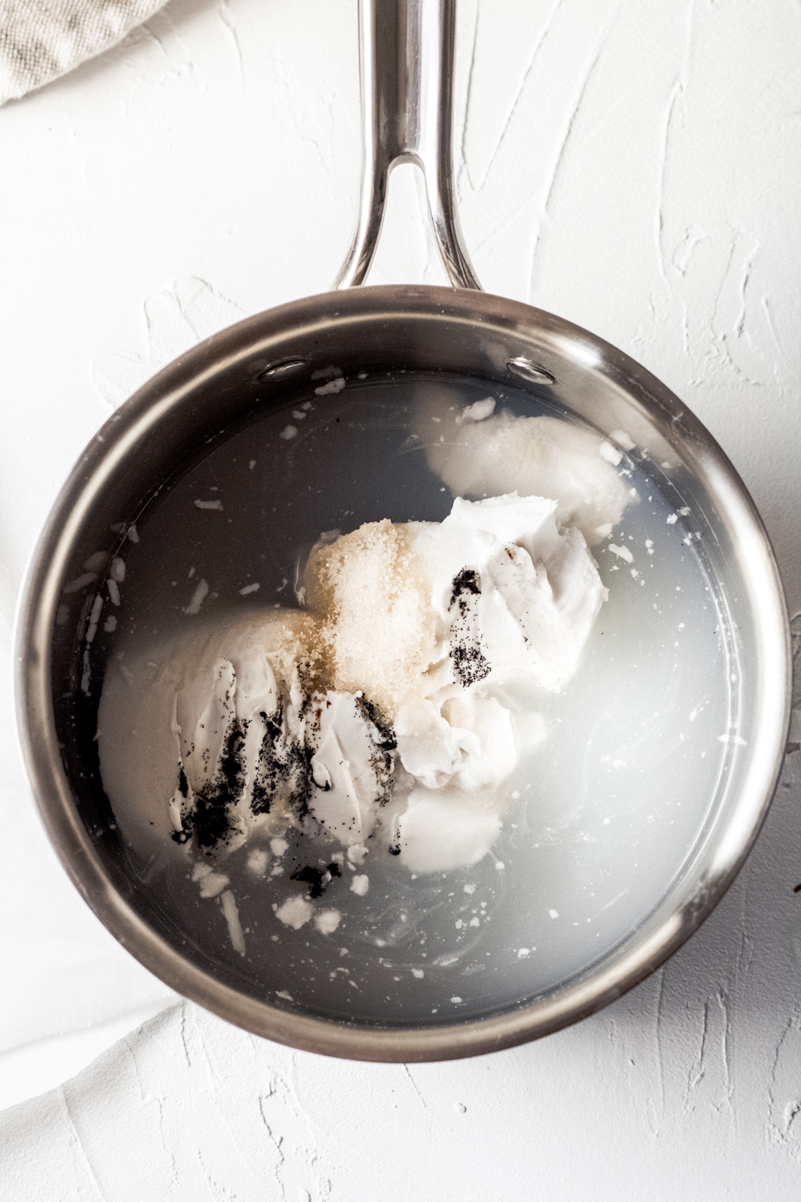 ingredients for vanilla coffee creamer in a saucepan