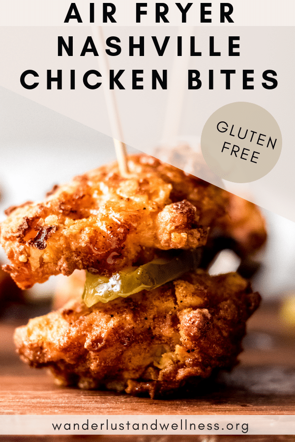 Two gluten-free air fryer Nashville chicken bites on a sandwich toothpicks with a sliced dill pickle in between.