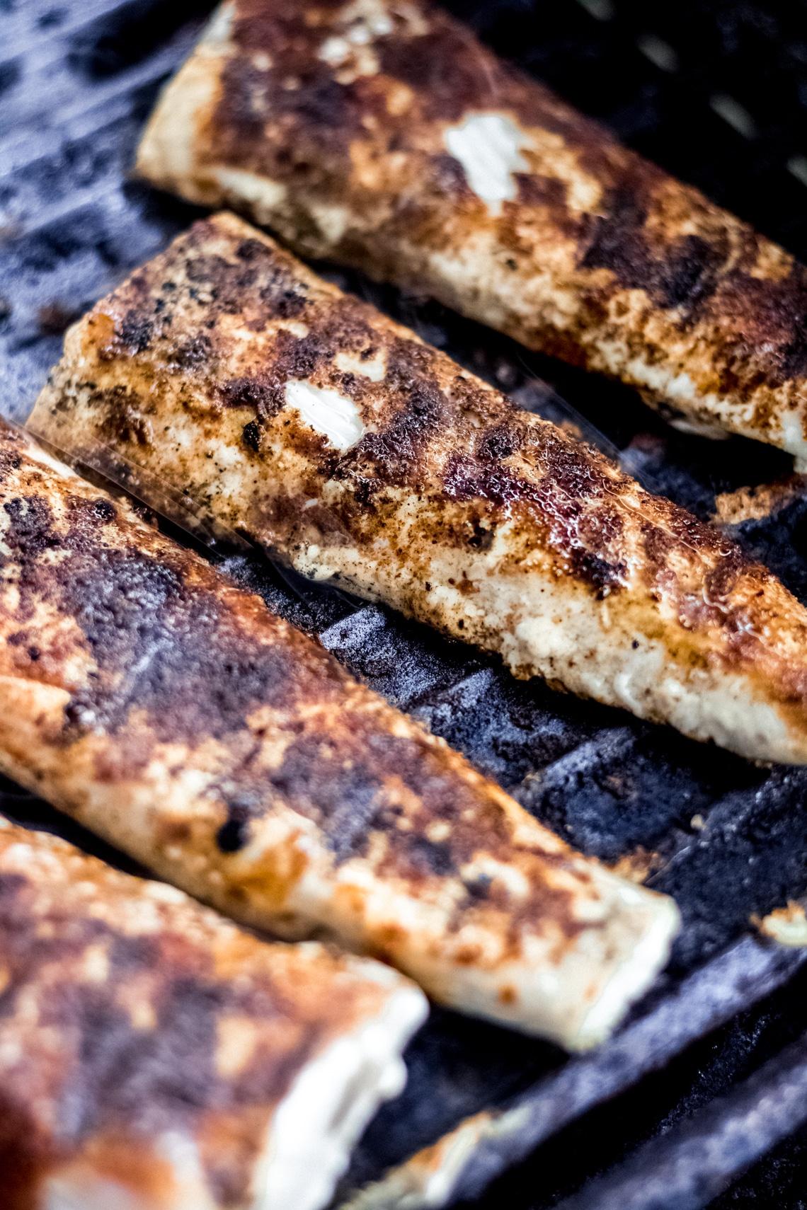 four Mahi Mahi fillets on the grill