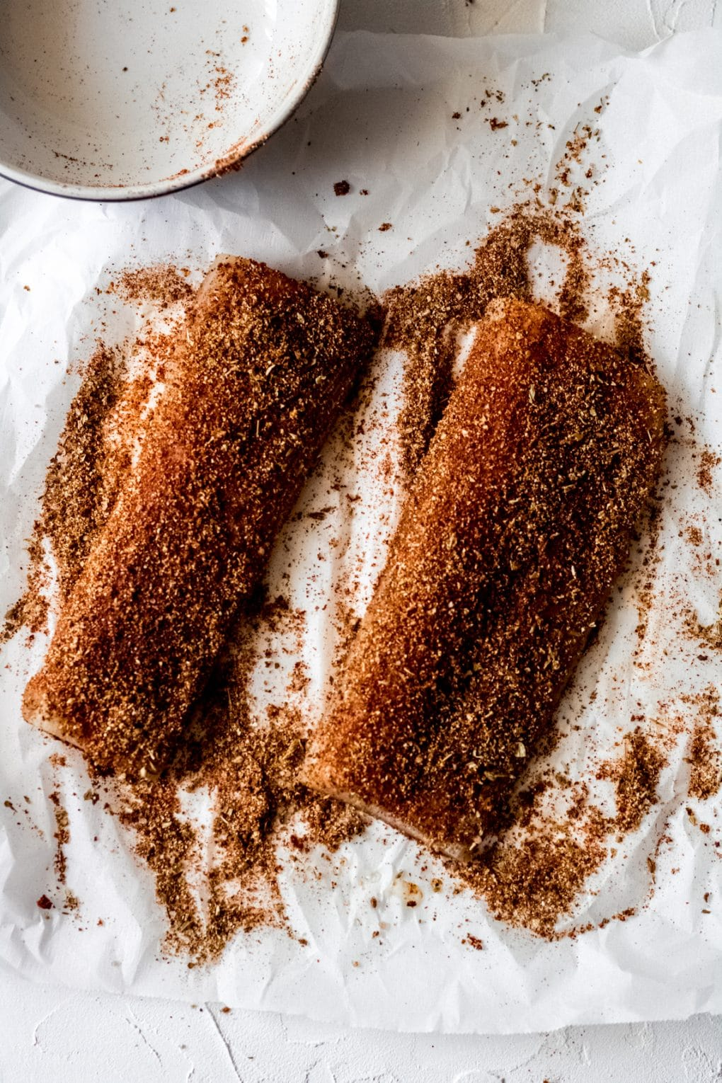 two Mahi Mahi fillets coated in blackening spices