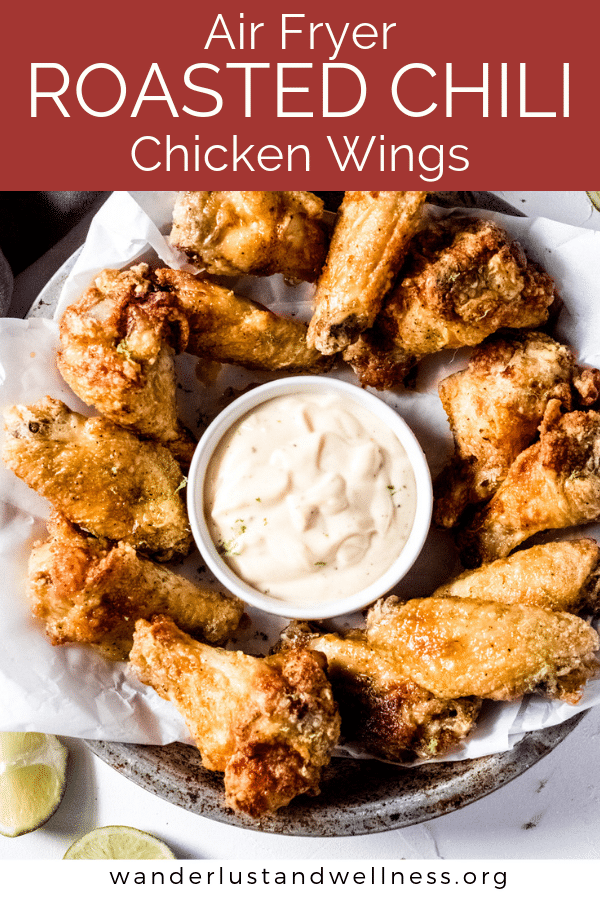 a plate of air fryer roasted chili chicken wings with aioli sauce in a dish in the middle
