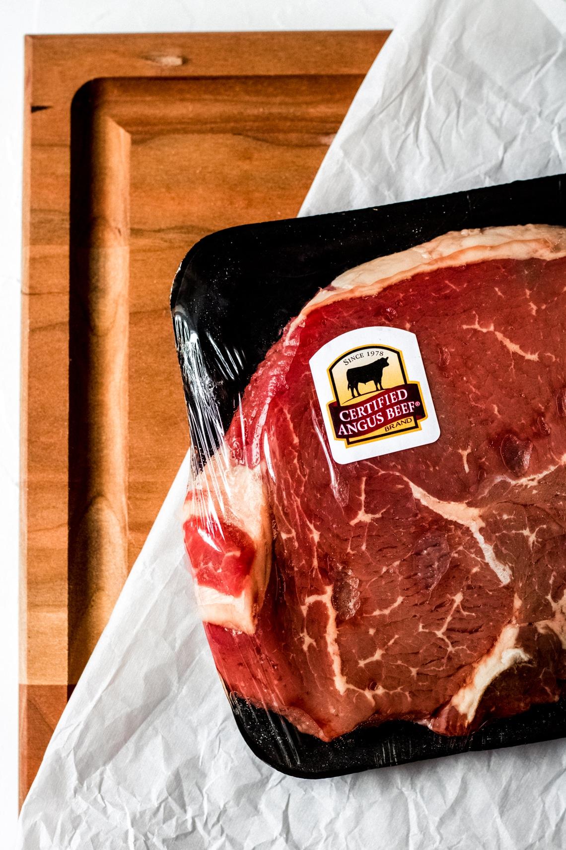 a raw certified angus beef sirloin steak