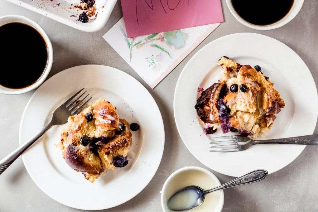two servings of blueberry french toast bake on two white plates.
